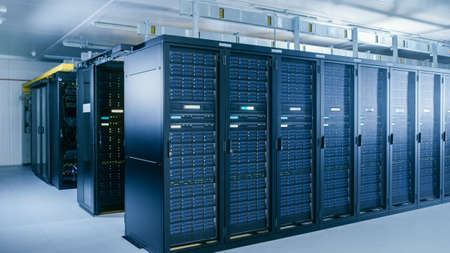 Shot of Data Center With Multiple Rows of Fully Operational Server Racks. Modern Telecommunications, Cloud Computing, Artificial Intelligence, Database, Supercomputer Technology Concept.