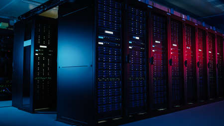 Shot of Data Center With Multiple Rows of Fully Operational Server Racks. Modern Telecommunications, Artificial Intelligence, Supercomputer Technology Concept. Shot in Dark with Neon Blue, Pink Lights
