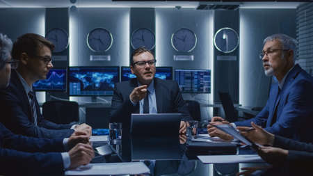 Senior Government Member Holds an Impromptu Meeting with His Team of Advisors at the Emergency Operations Center. Agency Director Gives Orders to His Subordinates in the Negotiations Room.