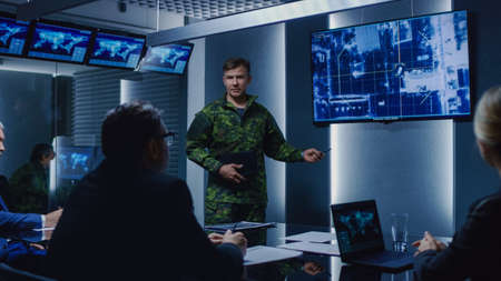 High-Ranking Military Man holds a Briefing to a Team of Government Agents and Politicians, Shows Footage of Satellite Following Target Car Surveillance.