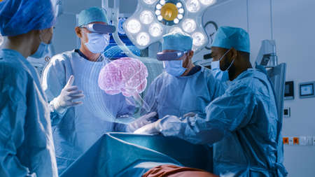 Surgeons Wearing Augmented Reality Glasses Perform Brain Surgery with Help of Animated 3D Brain Model, Using Gestures. High Tech Technologically Advanced Hospital. Futuristic Theme.