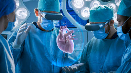 Surgeons Perform Heart Surgery Using Augmented Reality Technology. Difficult Heart Transplant Operation Using 3D Animation and Gestures. Interactive Animation Shows Vital Signs. Futuristic Hospital. Stock fotó