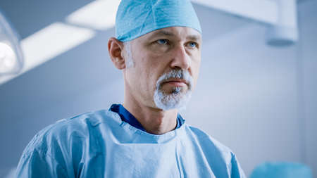 Portrait of the Serious Professional Surgeon Before Surgery Operation. Modern Hospital Operating Room.