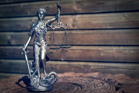 femida: sculpture of themis, femida or justice goddess on wood lining background Stock Photo