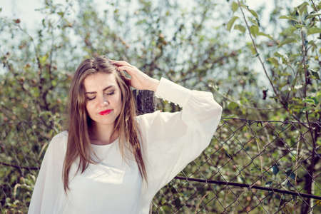 closeup portrait of elegant beautiful young lady in sadness on summer outdoors copy space background photo
