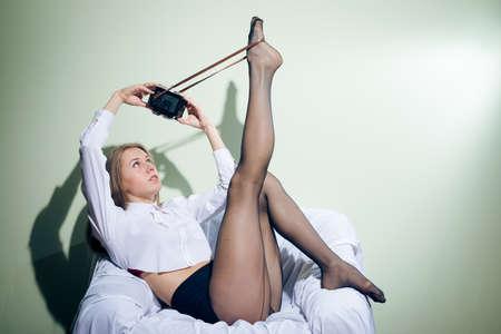 selfy: portrait of beautiful glamour young lady having fun making selfy image on retro camera
