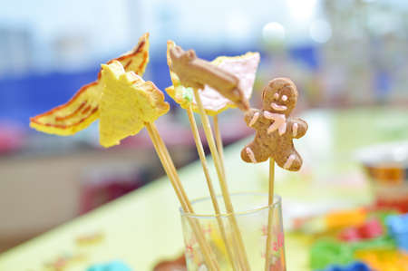 bickie: picture of handmade cookies on stick in glass