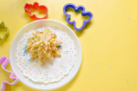 bickie: image of hand made cake or cookies on white plate with molds around
