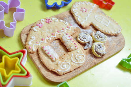 picture of gingerbread cookies on wooden desk background photo