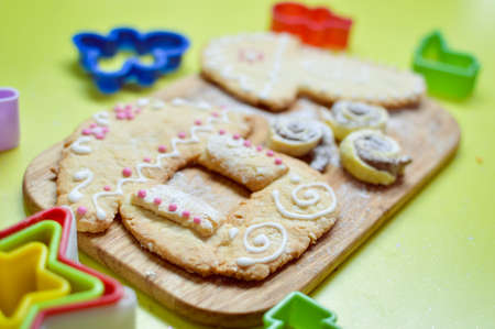 gingerbread cookies on wooden desk background photo