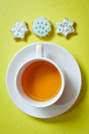 Image of three ginger cookies and cup of tea photo