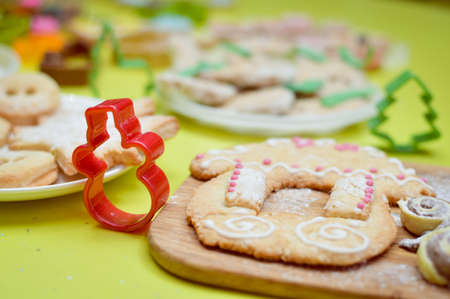 Gingerbread house on wooden desk and light green background photo