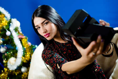 selfy: image of beautiful glamour lady in leather jacket having fun making selfy picture