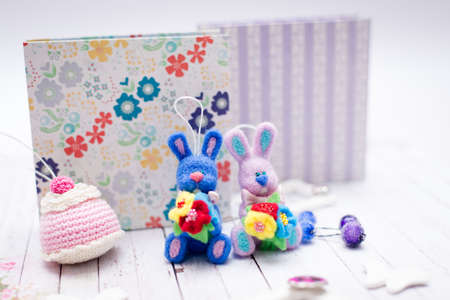 Picture of handmade knitted bunny rabbits and gift boxes photo
