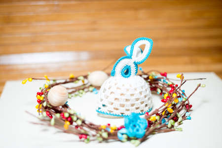 osier: Picture of knitted gift with decoration elements around on wooden copy space background Stock Photo