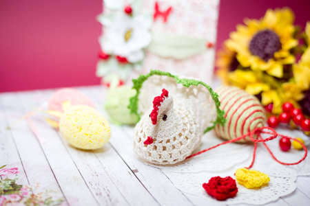 Close up picture on set of colorful eggs and gift decorations photo