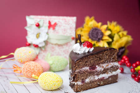 Picture close up on set of cake, colorful eggs and gift decorations photo