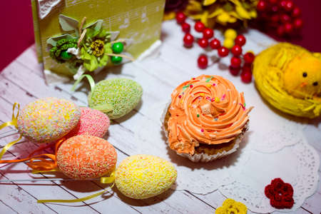 Close up image on set of cake, colorful eggs and gift decorations photo