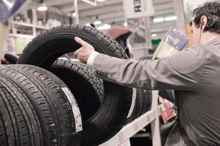 Picture of person holding a tire or tyre