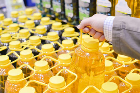 Picture of person choosing or packing bottles in row on copy space background