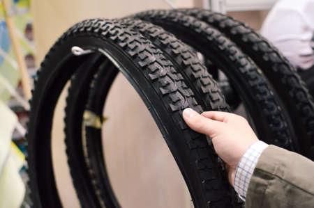 travelling salesman: Closeup picture on hand choosing or presenting cycle spare tire