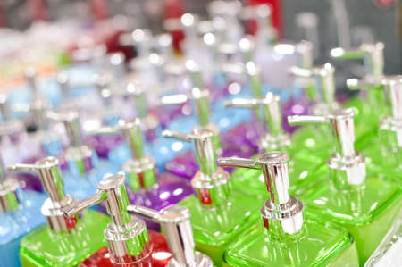 Row of several bottles in different colors Stock Photo