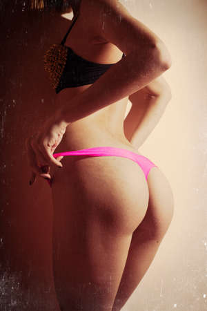 nude butt: Sexy fitness girl with excellent butt having fun posing in pink underwear, closeup image