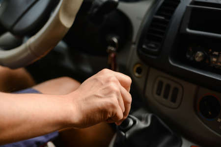 beeping: Mans hands holding a wheel of a car