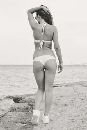 sexi: Black and white picture of sexi girl with a perfect figure standing at the sea