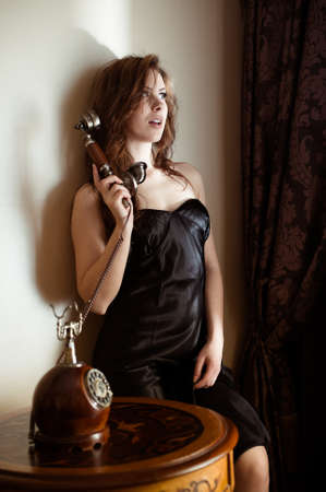 waiting phone call: Portrait of beautiful sensual young lady with stylish phone