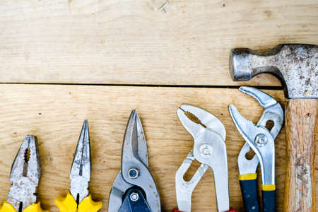 handtools: Close up picture of toolkit with hammer, set of wrenches over wooden background copyspace Stock Photo