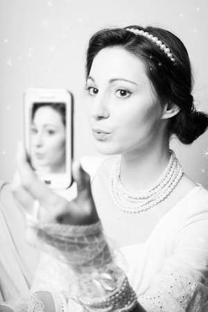 selfy: Black and white photography close up on taking selfy with smart phone beautiful lady having fun.
