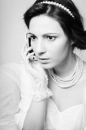 lady on phone: Black and white photography close up of talking on smart phone elegant beautiful lady looking serious. Stock Photo