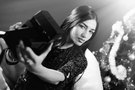 selfy: Beautiful glamour lady in having fun making selfy picture. Black and white portrait