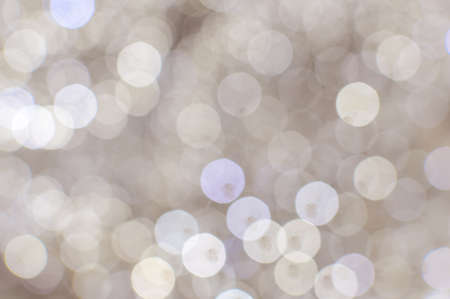 holiday picture: Picture of light blurred background with white bokeh lights on it. Festive holiday theme with copyspace
