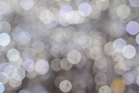 Picture of beautiful winter blurred background with white and yellow bokeh. Artistic effect background for festive decor.