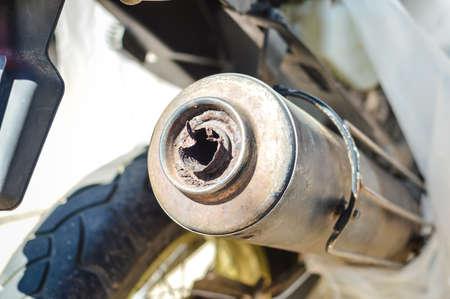 motobike: Closeup on exhaust of motobike on sunny outdoors background Stock Photo