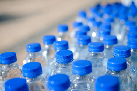 water bottles: Closeup on mineral water bottles in raw and lines