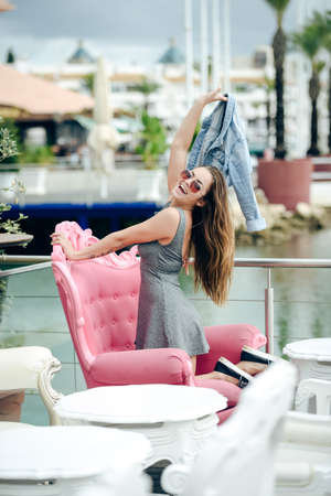 vilamoura: Beautiful joyful happy smiling pretty female in restaurant on luxury marina background. enjoying travel life concept