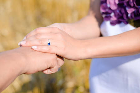 incurable: Partnership, trust and social ethics concept. Friendly female hands holding male hand for encouragement and empathy.