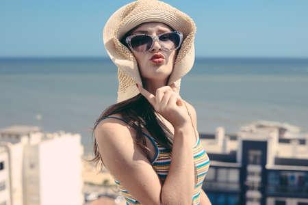 honeymoon suite: Beautiful woman luxury relaxing enjoying sun on blue sky sea outdoors background