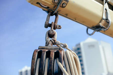 Closeup view of ship rope tackles on outdoors sunny blue sky background