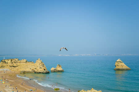 Atlantic ocean view of Algarve coastline. Beautiful seascape sunny beach in Lagos Portugal. Dream vacation picturesque destination. Serenity location for relaxation and contemplation.