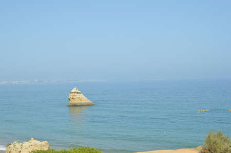 pleasing: Atlantic ocean view of Algarve coastline. Beautiful seascape sunny beach in Lagos Portugal. Dream vacation picturesque destination. Serenity location for relaxation and contemplation.