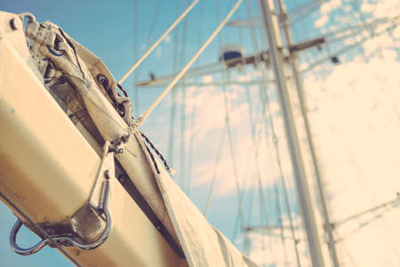 Vintage picture of beautiful sail boat details. Rope, hull, rigging sailing yacht background