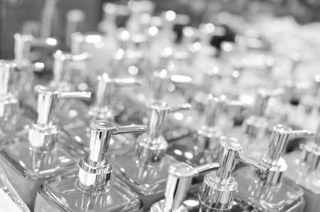 Black and white photography of bottles in row, close up