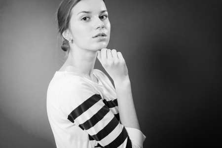 Black and white photography of beautiful young woman in striped top copy space background Stock Photo