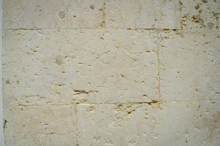Closeup of natural pattern of stone wall building textured background Stockfoto - 111702113
