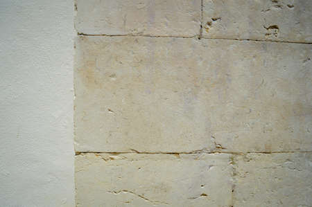 Closeup of natural pattern of stone wall building textured background