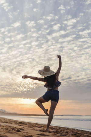 Dance and jump beautiful female silhouette on outdoors background. Dawn sky enjoyment time Stock Photo